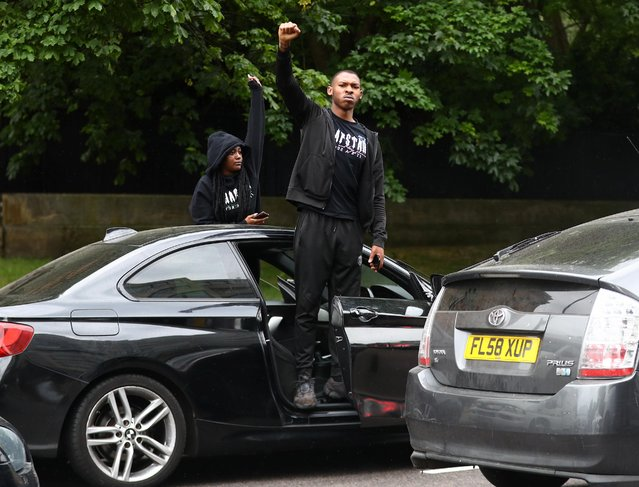 """A man reacts from his car in Park Lane during a """"Black Lives Matter"""" protest following the death of George Floyd who died in police custody in Minneapolis, London, Britain, June 3, 2020. (Photo by Hannah McKay/Reuters)"""