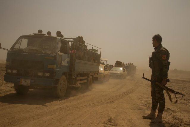 Hundreds of civilians flee villages outside Mosul the day after Iraqi Kurdish forces launch an operation east of Islamic State-held Mosul on Monday, August 15, 2016. The Kurdish forces known as the Peshmerga say they have retaken 12 villages in the operation in an effort to encircle the city. (Photo by Susannah George/AP Photo)