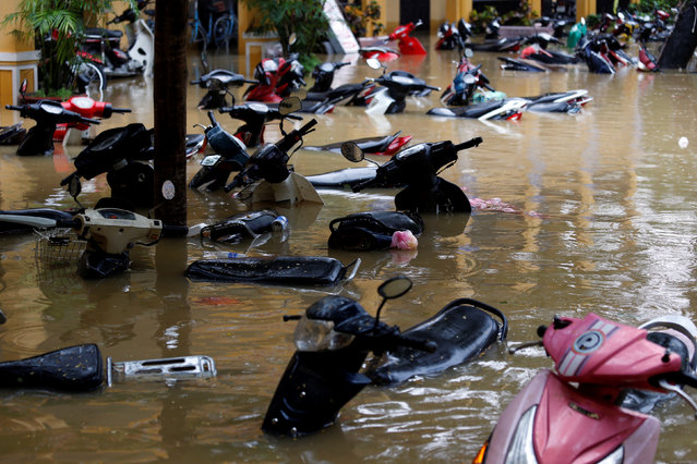 Motorbikes are seen along a flooded street at the UNESCO heritage ancient town of Hoi An after typhoon Damrey hits Vietnam on November 6, 2017. (Photo by Reuters/Kham)