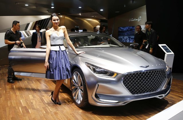 A model poses at the Hyundai Vision G car during the media day at the Frankfurt Motor Show (IAA) in Frankfurt, Germany, September 15, 2015. (Photo by Kai Pfaffenbach/Reuters)