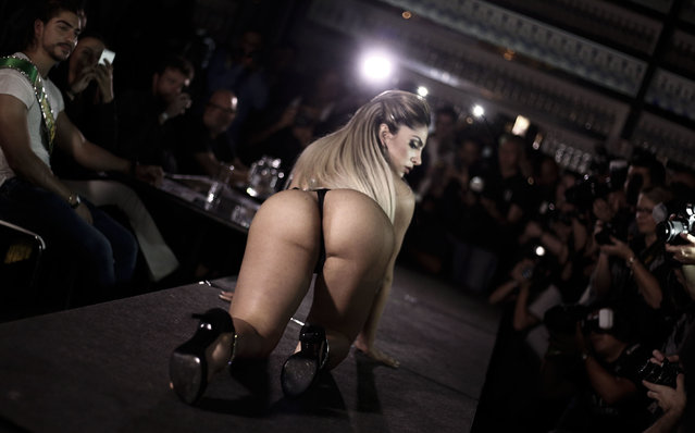 A competitor poses on the catwalk during the Miss Bumbum Brazil 2016 pageant in Sao Paulo, Brazil on November 9, 2016. (Photo by Miguel Schincariol/AFP Photo)