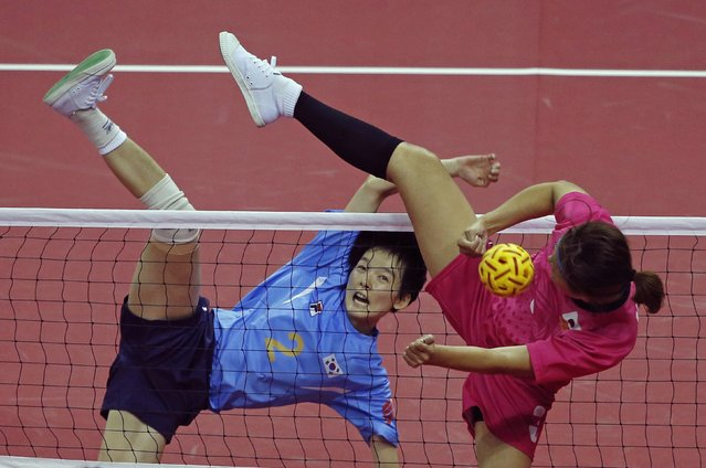 South Korea's Kim I-seul (rear) kicks over Japan's Chiharu Yano during their women's sepak takraw game at the Bucheon Gymnasium during the 17th Asian Games in Incheon October 1, 2014. (Photo by Jason Reed/Reuters)