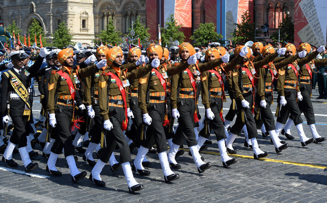 A parade formation of the Indian Armed Forces soldiers marches during a military parade, marking the 75th anniversary of the Nazi defeat, in Moscow, Russia, 24 June 2020. The Victory Day military parade normally is held on 09 May, the nation's most important secular holiday, but this year it was postponed due to the coronavirus pandemic. (Photo by Sergey Pyatakov/EPA/EFE)