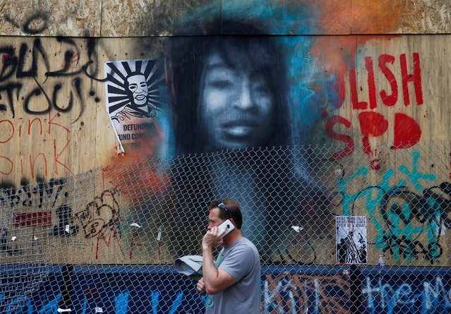 A depiction of Charleena Lyles, a Black woman killed by Seattle Police in 2017, is seen on plywood outside the Seattle Police Department's East Precinct at the CHAZ/CHOP zone during continued protests against racial inequality and for defunding of police in the aftermath of the death in Minneapolis police custody of George Floyd, in Seattle, Washington, U.S. June 14, 2020. (Photo by Lindsey Wasson/Reuters)