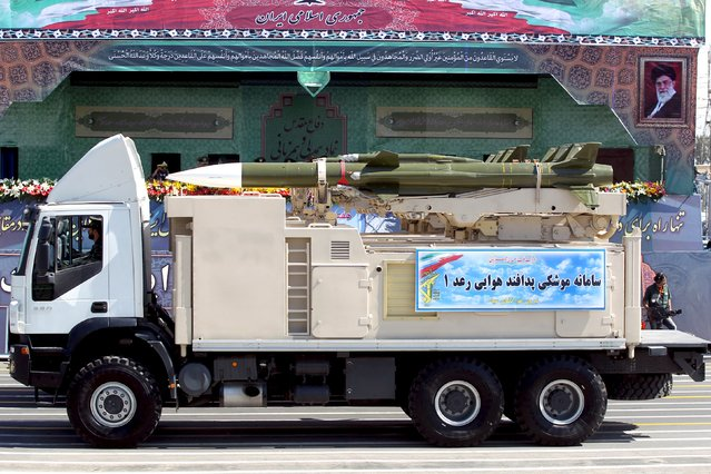 A military truck carrying a Raad missile drives past a picture of Iran's Supreme Leader Ayatollah Ali Khamenei (R) during a parade marking the anniversary of the Iran-Iraq war (1980-88), in Tehran September 22, 2015. (Photo by Raheb Homavandi/Reuters/TIMA)