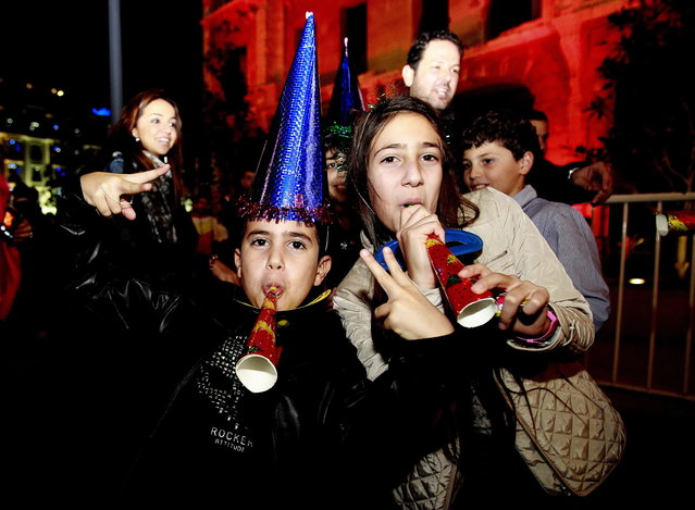 Lebanese children celebrate on new year's eve in Beirut, early on January 1, 2013. (Photo by Anwar Amro/AFP Photo)