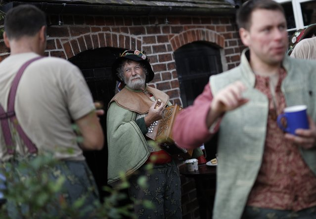 Dancers take a break during the Abbots Bromley Horn Dance in Abbots Bromley, Britain, September 12, 2016. (Photo by Darren Staples/Reuters)