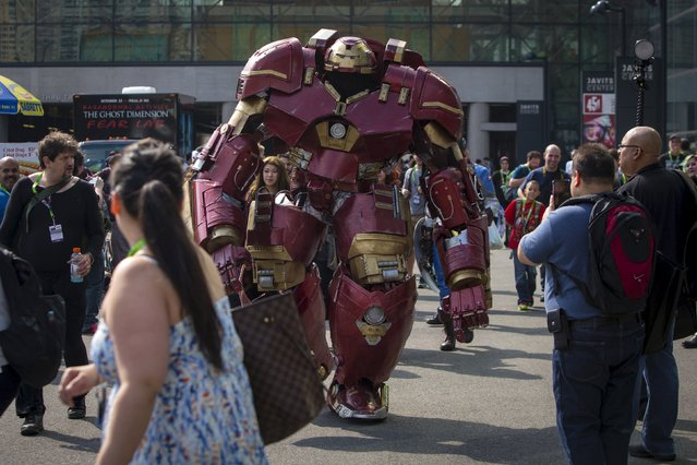 A person dressed as Hulkbuster walks amongst attendees on day two of New York Comic Con in Manhattan, New York, October 9, 2015. (Photo by Andrew Kelly/Reuters)