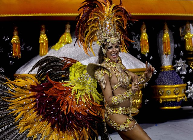 A dancer from the Gavioes da Fiel samba school performs during a carnival parade in Sao Paulo, Brazil,  early Sunday, February 10, 2013. (Photo by Andre Penner/AP Photo)