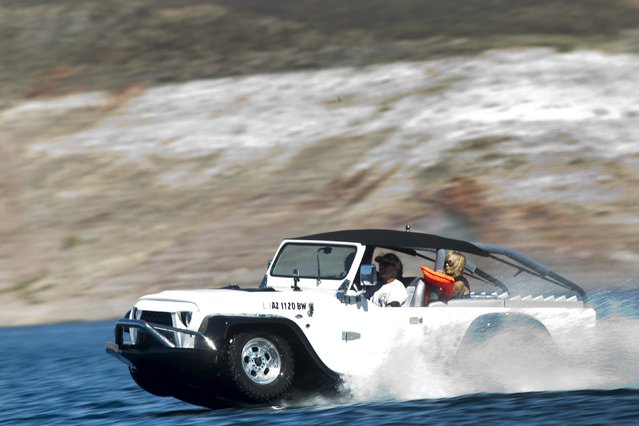 Bob Davis of Bullhead City, Arizona drives a Panther WaterCar during the first Las Vegas Amphicar Swim-in at Lake Mead near Las Vegas, Nevada October 9, 2015. (Photo by Steve Marcus/Reuters)