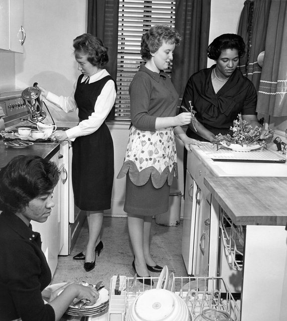 In this March 1963 file photo, black and white students participate in a home economics class at West Virginia State College at Institute, W.Va. The school, one of a number in which reverse integration is taking place, has changed from a predominantly African-American college to one with 65-to-70 per cent white students in its student body of 2,502. (Photo by AFP Photo)
