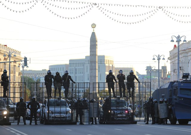 Law enforcement officers block a street during an opposition rally to demand the resignation of Belarusian President Alexander Lukashenko more than a month after the disputed presidential election, in Minsk, Belarus on September 20, 2020. (Photo by Tut.By via Reuters)