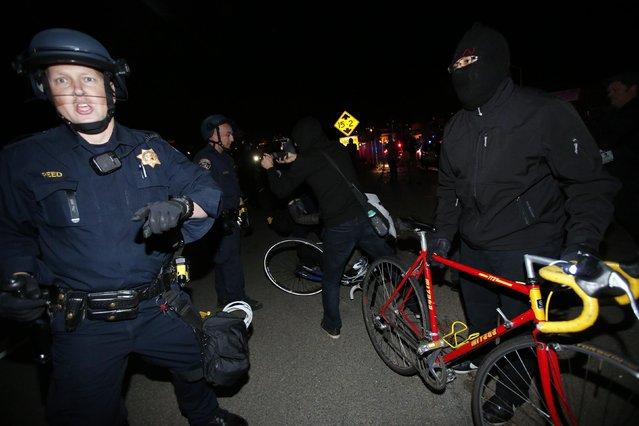 Police officers scuffle with demonstrators on Highway 580 during a demonstration following the grand jury decision in the Ferguson, Missouri shooting of Michael Brown, in Oakland, California November 24, 2014. (Photo by Stephen Lam/Reuters)
