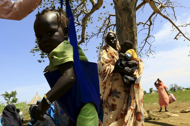 A child is weighed during visit by a European Union delegation, at an IDP camp in Azaza, east of Ed Damazine, capital of Blue Nile state, October 21, 2015. (Photo by Mohamed Nureldin Abdallah/Reuters)
