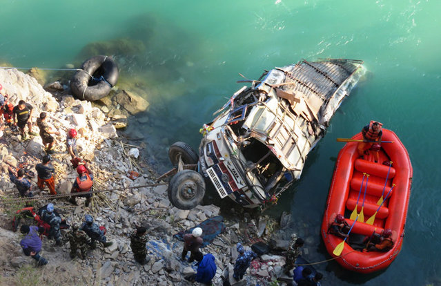 Rescue workers searching for the victims of a bus crash in Bheri river, Jajarkot District, about 400 km west of the capital Kathmandu, Nepal, November 24, 2014. (Photo by Bhim Bshadur Singh/EPA)