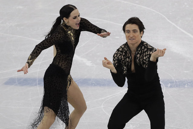 Tessa Virtue and Scott Moir of Canada perform during the ice dance, short dance figure skating in the Gangneung Ice Arena at the 2018 Winter Olympics in Gangneung, South Korea, Monday, February 19, 2018. (Photo by David J. Phillip/AP Photo)
