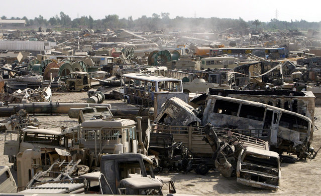 Wrecks of Iraqi military vehicles lie in a dump on the outskirts of Baghdad, on May 25, 2003. The vehicles brought here were destroyed when U.S.-led strikes used depleted uranium shells against tanks and other armored vehicles during the war that ousted Saddam Hussein. Iraqi doctors and scientists are worried that birth defects and childhood cancers could surge in the aftermath of the latest conflict, not unlike medical problems in southern Iraq after the mildly radioactive munitions were first used in the 1991 Gulf War. (Photo by Jamal Saidi/Reuters/The Atlantic)