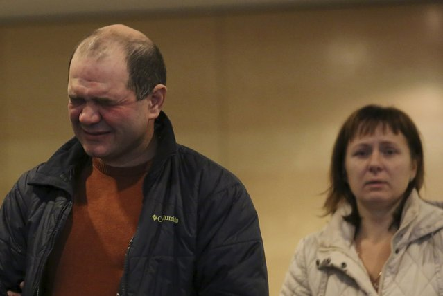 Relatives of victims of a Russian airliner which crashed in Egypt, mourns at a hotel near Pulkovo airport in St. Petersburg, Russia, October 31, 2015. The Airbus A321, operated by Russian airline Kogalymavia under the brand name Metrojet, carrying 224 passengers and crew crashed in Egypt's Sinai peninsula on Saturday after losing radar contact and plummeting from its cruising altitude, killing all aboard. (Photo by Peter Kovalev/Reuters)
