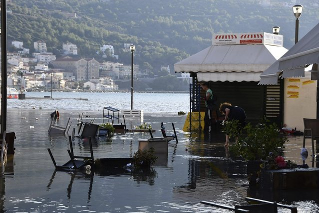 Seawater covers a square after an earthquake at the port of Vathi on the eastern Aegean island of Samos, Greece, Friday, October 30, 2020. A strong earthquake struck in the Aegean Sea between the Turkish coast and the Greek island of Samos as the magnitude 6.6 earthquake was centered in the Aegean at a depth of 16.5 kilometers, or 10.3 miles. (Photo by Michael Svarnias/AP Photo)