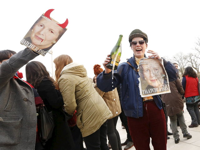 """Revellers celebrate the death of Britain's former prime minister Margaret Thatcher in Brixton, south London April 8, 2013. Margaret Thatcher, the """"Iron Lady"""" who transformed Britain and inspired conservatives around the world by radically rolling back the state during her 11 years in power, died on Monday following a stroke. She was 87. (Photo by Olivia Harris/Reuters)"""