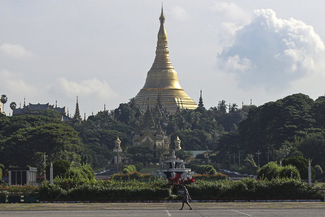 A man takes his morning walk near the Shwedagon pagoda in Yangon, Myanmar, on Thursday, November 5, 2020. (Photo by Thein Zaw/AP Photo)