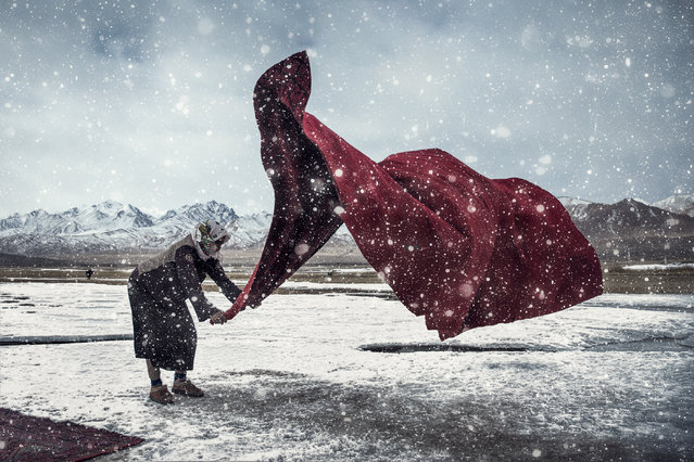 Open enhanced and the China national award third-place winner: Zhou Jianguang. Zhou's image is titled Working in the Wind and Snow. The competition received 320,000 entries from more than 200 territories and countrie. (Photo by Zhou Jianguang/Sony World Photography Awards 2018)