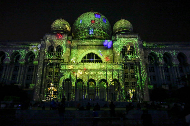 The Malaysia administration office building, Palace of Justice, is illuminated with lighting and graphic during the Putrajaya Lighting and Motion Festival 2014, in Putrajaya, outside Kuala Lumpur, Malaysia, December 13, 2014. The festival was held from December 12 to 13. (Photo by Azhar Rahim/EPA)