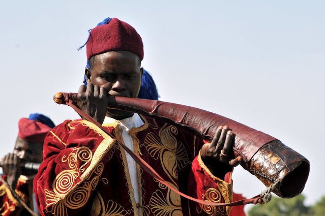 A flutist is pictured in front of the entourage of Emir of Kano Sanusi Lamido Muhammadu II at the closing ceremony of The Emir of Katsina Charity Shield at the Fifth Chukker in Kaduna, Nigeria November 7, 2015. (Photo by Reuters/Stringer)