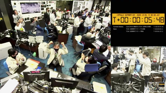In this image made from video provided by the Japan Aerospace Exploration Agency (JAXA), its members react at the command center in Sagamihara, west of Tokyo, Saturday, December 5, 2020, after JAXA officials confirmed the successful separation of a capsule from the Hayabusa2 spacecraft. Japan's space agency said the Hayabusa2 spacecraft successfully separated the capsule and sent it toward Earth to deliver samples from a distant asteroid that could provide clues to the origin of the solar system and life on our planet. (Photo by JAXA via AP Photo)