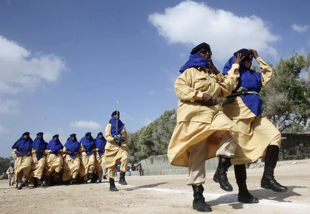 Somali policewomen march in a passing out parade during celebrations to mark the Somali Police Force's 71st founding anniversary in the capital Mogadishu December 20, 2014. (Photo by Ismail Taxta/Reuters)