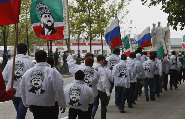 Members of a youth club supporting former Chechen leader Akhmad Kadyrov march along the street during a rally in the centre of the Chechen capital Grozny April 25, 2013. (Photo by Maxim Shemetov/Reuters)
