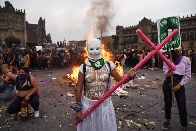 A woman poses for a photo while taking part in a protest during the International Women's Day, in Mexico City, on March 8, 2020. Women around the globe are taking action to mark International Women's Day and to push for action to obtain equality. (Photo by Victoria Razo/AFP Photo)
