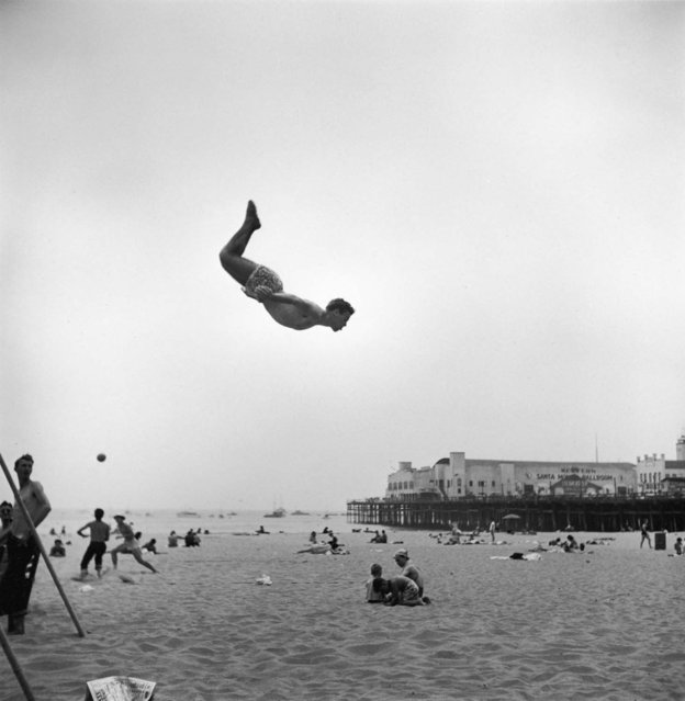 A man flies off a trampoline at Santa Monica Beach, Calif., on July 1, 1948. (Photo by Loomis Dean/Time & Life Pictures)