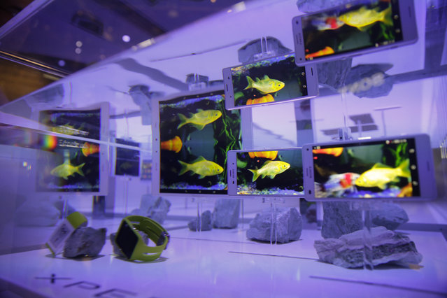 Sony Xperia Z3 tablet and smartphones are displayed in water at the Sony booth during a news conference at the International CES Monday, January 5, 2015, in Las Vegas. (Photo by Jae C. Hong/AP Photo)