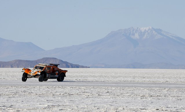 SMG driver Ronan Chabot of France drives on the Salar de Uyuni salt flat during the 8th stage of the Dakar Rally 2015, from Uyuni to Iquique, January 11, 2015. (Photo by Jean-Paul Pelissier/Reuters)