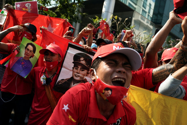 NLD supporters shout slogans in front of the Myanmar embassy during a rally after the military seized power from a democratically elected civilian government and arrested its leader Aung San Suu Kyi, in Bangkok, Thailand on February 1, 2021. (Photo by Athit Perawongmetha/Reuters)