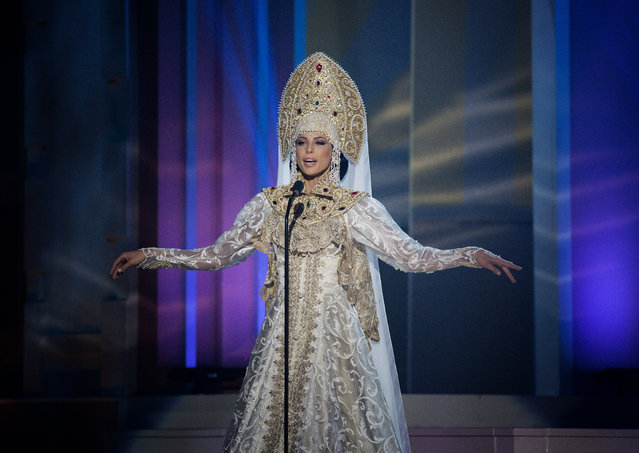 Miss Russia, Yulia Alipova, poses for the judges, during the national costume show during the 63rd annual Miss Universe Competition in Miami, Fla., Wednesday, January 21, 2015. (Photo by J. Pat Carter/AP Photo)