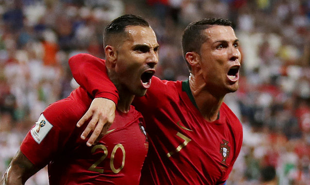 Portugal' s forward Ricardo Quaresma (L) celebrates scoring the opening goal with Portugal' s forward Cristiano Ronaldo during the Russia 2018 World Cup Group B football match between Iran and Portugal at the Mordovia Arena in Saransk on June 25, 2018. (Photo by Ricardo Moraes/Reuters)