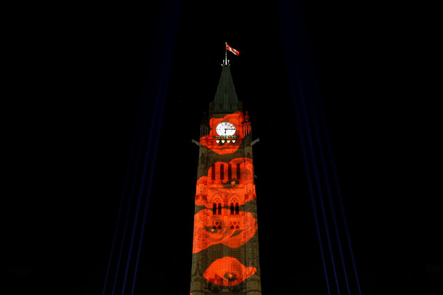 "Poppies are projected on the Peace Tower as part of the Royal Canadian Legion's ""virtual poppy drop"" on Parliament Hill, ahead of Remembrance Day, in Ottawa, Ontario, Canada, November 10, 2016. (Photo by Chris Wattie/Reuters)"