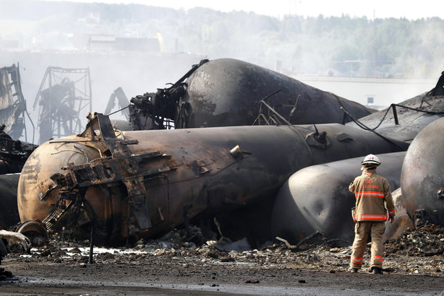 A firefighter at the scene of the train derailment in Lac-Megantic, on July 7, 2013. (Photo by Christinne Muschi/Reuters)