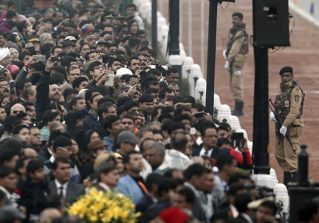 Spectators use their mobile phones to take photos of a cavalcade of U.S. President Barack Obama (not pictures) as he leaves after attending the Republic Day parade in New Delhi January 26, 2015. (Photo by Ahmad Masood/Reuters)