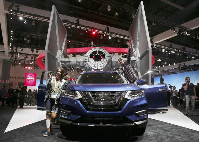 Star Wars fans climb on board as Nissan introduces the 2017 Nissan Rogue Star Wars Edition at the 2016 Los Angeles Auto Show in Los Angeles, California, U.S November 16, 2016. (Photo by Lucy Nicholson/Reuters)