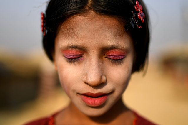 A Rohingya refugee girl named Amina poses for a photograph as she wears thanaka paste at Kutupalong camp in Cox's Bazaar, Bangladesh, March 30, 2018. (Photo by Clodagh Kilcoyne/Reuters)