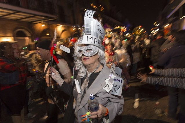 A member of Krewe Delusion, one of the first parades of the Mardi Gras festivities, marches through the French Quarter of New Orleans January 31, 2015. (Photo by Lee Celano/Reuters)