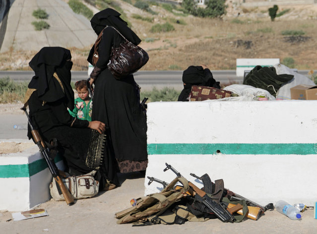 Women arrive in Hama from Deraa, Syria on July 21, 2018. (Photo by Khalil Ashawi/Reuters)
