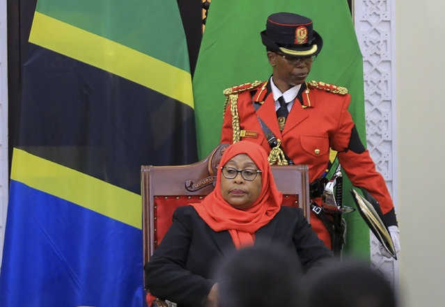 Tanzania's new president Samia Suluhu Hassan, center, is sworn in at a ceremony at State House in Dar es Salaam, Tanzania Friday, March 19, 2021. Samia Suluhu Hassan made history Friday when she was sworn in as Tanzania's first female president, following the death of her predecessor John Magufuli. (Photo by AP Photo/Stringer)