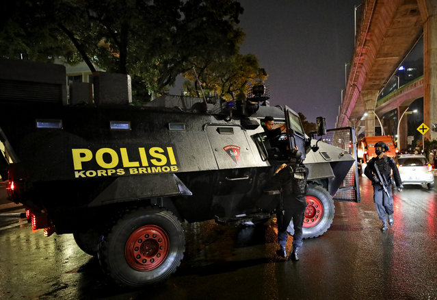 A police armored vehicle is parked outside the National Police Headquarters following a suspected militant attack in Jakarta, Indonesia, Wednesday, March 31, 2021. A woman entered the Indonesian National Police Headquarters in Jakarta and pointed a gun at several officers before being shot dead by police, in the latest in a series of suspected militant attacks in the world's most populous Muslim nation. (Photo by Dita Alangkara/AP Photo)