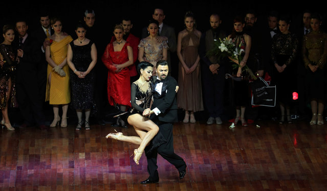 Dmitry Vasin and Sagdiana Khamzina, representing Moscow, Russia, dance in front of the other finalists after they won the Tango World Championship stage style at the Tango World Championship in Buenos Aires, Argentina on August 23, 2018. (Photo by Marcos Brindicci/Reuters)