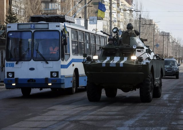 Members of the Ukrainian armed forces ride on an armoured personnel carrier (APC), in Kramatorsk, eastern Ukraine February 11, 2015. (Photo by Gleb Garanich/Reuters)