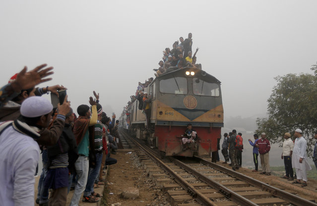 Bangladeshi Muslim devotees arrive in an over-crowded train to attend the final day of an Islamic congregations' first phase in Tongi, 20 kilometers (13 miles) north of  Dhaka, Bangladesh, Sunday, January 10, 2016. The second phase of the annual event, one of the world's largest congregations of Muslims is scheduled to begin Friday. (Photo by A.M. Ahad/AP Photo)
